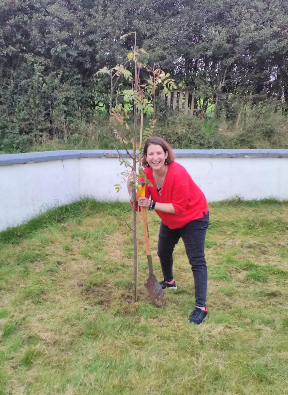 Eve Menezes Cunningham planting a tree September 2019