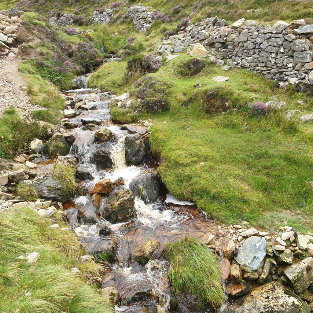 stream and stone wall on way up the Reek (aka Croagh Patrick mountain) in Ireland